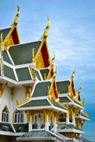 Buddhist temple. Roof of a Buddhist temple with typical golden ornaments Stock Image