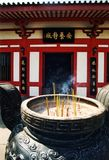 Buddhist temple. Incense burning in front a Buddhist temple in Hong Kong Royalty Free Stock Photography