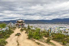 Buddhist Temple above City. A small Buddhist pagoda sits on the edge of a hill above the city of Shangri-la in northern Yunnan province Royalty Free Stock Photography