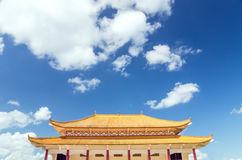 Buddhist temple against a blue sky with dramatic clouds Royalty Free Stock Image