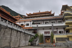 Buddhist temple. The architectural style is to use the ancient Chinese traditional style, the eaves of golden roofs and carved dragon embroidered chicken, is Royalty Free Stock Photography