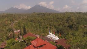 Buddhist temple on Bali. Buddhist temple Vihara Dharma Giri with sleeping buddha. aerial view buddhist temple in mountains Bali Travel concept. indonesia stock footage