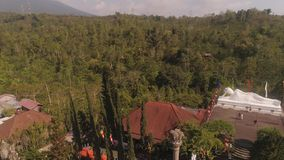 Buddhist temple on Bali. Buddhist temple Vihara Dharma Giri with sleeping buddha. aerial view buddhist temple in mountains Bali Travel concept. indonesia stock video footage