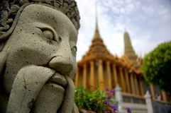 Buddhist temple Bangkok. Temple in Bangkok with statue Royalty Free Stock Photo