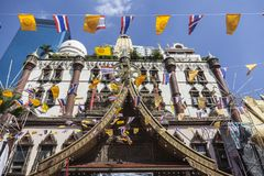 Buddhist temple in Bangkok near Khlong channel. Decorated with flags Royalty Free Stock Photography