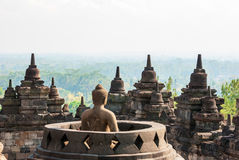 Buddhist temple Borobudur, Magelang, Indonesia. Buhhdist temple Borobudor with buddha and stuffa with view over the landscepe arround,  Yogyakarta, Indonesia Stock Photography