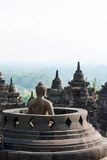Buddhist temple Borobudur, Magelang, Indonesia. Buhhdist temple Borobudor with buddha and stuffa with view over the landscepe arround,  Yogyakarta, Indonesia Stock Images