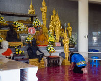 In a Buddhist temple, a Buddhist bows to shrines. Stock Photo