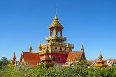 Buddhist Temple Wat roof in Thailand, thai traditional religious arcitecture. Buddhist Temple building with golden decoration, ornament and Buddha statues. Wat stock images