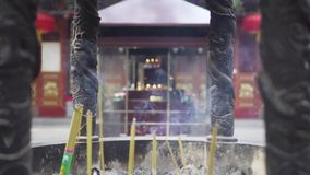Buddhist temple burning incense sticks. Xi`an Wolon Temple. China. Travel Asia stock footage