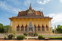 Buddhist Temple in Cambodia. The exterior facade of a colorful Buddhist temple against a blue sky in Cambodia Royalty Free Stock Image