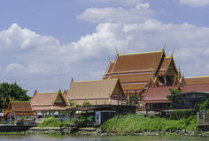A buddhist temple at a canal in Bangkok. Royalty Free Stock Images