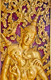 Buddhist Temple Carving Detail. A detail of a temple carving in Laos Stock Image