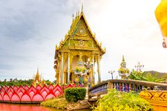Buddhist temple with crossed bridge and giant statue at Wat Plai. Lam, Koh Samui, Thailand Royalty Free Stock Images