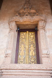 Buddhist temple door decoration in the capital of Vientiane, Royalty Free Stock Images