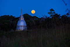 Buddhist temple and full moon Royalty Free Stock Photography