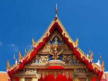 Buddhist temple gable soars into blue sky Royalty Free Stock Images