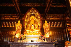 Buddhist Temple. Golden statue of Buddha. Stock Images