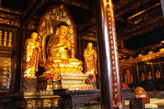 Buddhist Temple. Golden statue of Buddha royalty free stock photography