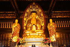 Buddhist Temple. Golden statue of Buddha Stock Photography