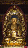 Buddhist Temple. Golden statue of Buddha Royalty Free Stock Images