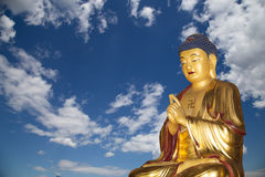 Buddhist Temple. Golden statue of Buddha Royalty Free Stock Image