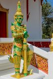 Buddhist Temple Guard in Thailand wat. Thai Buddhist Temple stone Guardian Giant Suriyaphob, mythological guard statue in Thailand wat. Ancient mythological royalty free stock images