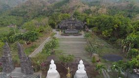 Buddhist temple on the island of Bali. Buddhist temple Brahma Vihara Arama with statues gods. aerial view balinese temple, old hindu architecture, Bali stock video