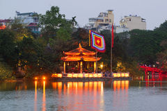 The Buddhist temple of the Jade mountain on the lake Hoankyem in evening twilight Stock Photo