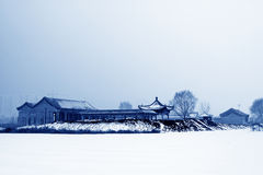 Buddhist Temple Landscape Architecture in the snow Stock Photography