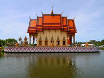 Buddhist temple on large lotus Royalty Free Stock Photography