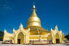 Buddhist temple of Maha Wizaya Pagoda close up in the sunny day. Yangon, Myanmar Royalty Free Stock Images