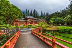 Buddhist Temple in Oahu. Byodo-In Buddhist Japanese Temple in Oahu, Hawaii. An elegant little bridge leads to the temple Stock Image
