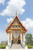 Buddhist temple. Ornate colorful Buddhist temple set against a blue sky background Thailand Stock Photography