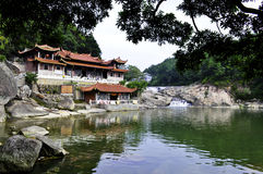A buddhist temple overlooking river pool Royalty Free Stock Images