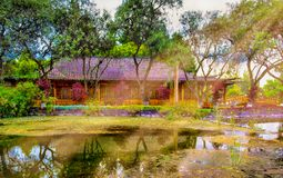Buddhist temple with a pond reflection stock photography