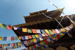 Buddhist Temple with Praying Flags Stock Photography