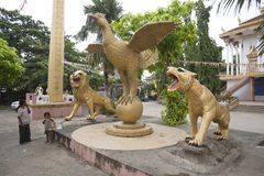 Buddhist temple. Religous sculptures painted in gold in Phnom Penh Royalty Free Stock Image