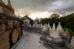 Buddhist Temple : Sandstone Pagoda in Pa Kung Temple at Roi Et of Thailand stock photos
