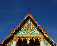 Buddhist temple soaring into blue sky royalty free stock photo