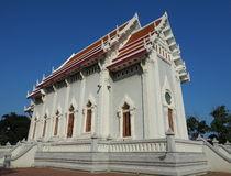 Buddhist temple soaring into blue sky Royalty Free Stock Images
