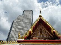 Buddhist temple and tall condominium building in Bangkok Stock Image