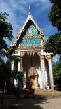 Buddhist temple in Thailand. In the tropical green with dogs on the porch stock photo