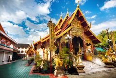 Buddhist temple in Thailand. Golden Pagoda with dragon in Buddhist monastery of Chiang Rai, Thailand Royalty Free Stock Images