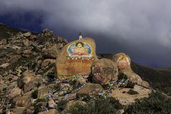 Buddhist temple tibet. Buddhist drawing on Rocks outside temple in Tibet Stock Photography