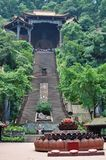 Buddhist temple on top of a steep staircase royalty free stock photos