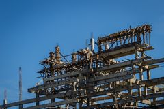 Buddhist temple under construction with blue sky background. Buddhist temple structure under construction with blue sky background. Selective focus Royalty Free Stock Photography