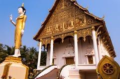 Buddhist temple Wat That Luang Neua in Vientiane, Laos. Golden Buddha statue & Buddhist temple Wat That Luang Neua in Vientiane, Laos Royalty Free Stock Photos
