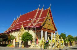 Buddhist Temple Wat pagoda in Thailand, thai traditional religious arcitecture. Buddhist Temple building with golden decoration, ornament and Buddha statues. Wat royalty free stock photo