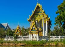 Buddhist Temple Wat in Thailand, thai traditional religious arcitecture. Buddhist Temple building with golden decoration, ornament and Buddha statues. Wat in stock photos